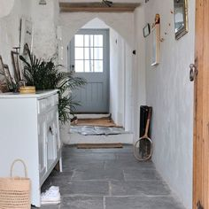 Stone flagged white country hallway