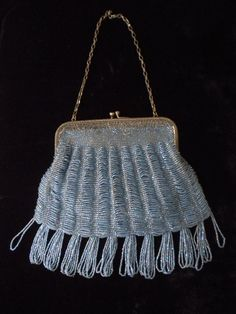 Vintage c.1920's baby blue glass beaded swag style handbag; silk lining w/rosebud trim. Kisslock silvertone filigree frame.