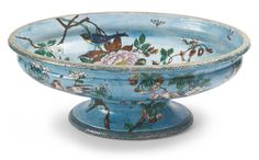 A THÉODORE DECK EARTHENWARE 'JAPONISME' LARGE FOOTED OVAL CENTERPIECE CIRCA 1875 painted on the interior and around the exterior with birds perched on flowering branches or in flight pursuing winged insects against a watery blue ground, impressed TH DECK. length 26 1/2 in. 67.3 cm