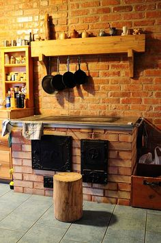 this wood stove heats the house and has an unusual chimney system that heats more brick to hold heat