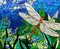 This piece has a background of bright blue and green glass, and the dragonfly has Iridescent wings. Description from fineartamerica.com. I searched for this on bing.com/images