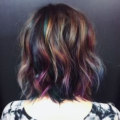 """Mesmerized by this oil slick color by @hairbykotay. Use #modernsalon and show us YOUR color creations!"""