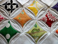 Searching for inspiration, I came across a Cathedral Window or Stained Glass Quilt. Originally, these quilts were made using muslin or chee...