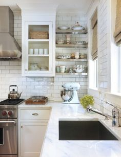 subway tile with light grey grout, stainless shelves
