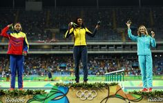 R) Silver medalist Yulimar Rojas of Venezuela, gold medalist Caterine Ibarguen of Colombia and bronze medalist Olga Rypakova of Kazakhstan pose on the podium during the medal ceremony for the Women's Triple Jump on Day 10 of the Rio 2016 Olympic Games at the Olympic Stadium on August 15, 2016 in Rio de Janeiro, Brazil.