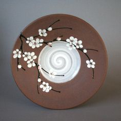 handmade stoneware plate for decoration or function with white plum blossoms in an Asian/Art Nouveau style via Etsy