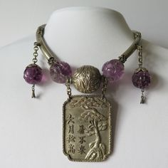 A Chinese Sterling Silver and Amethyst Necklace.