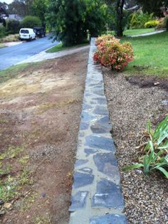 www.pavingcanberra.com Stone Retaining Wall. Retaining Wall Product: Blue stone - Wee Jasper stone Retaining Wall Design: Rock wall under 1 meter in height Drainage: Weep holes and 7mm River stones behind wall Retaining Wall Design, Stone Retaining Wall, Landscaping Retaining Walls, Coping Stone, Synthetic Lawn, Pool Coping, River Stones, Rock Wall, Jasper Stone