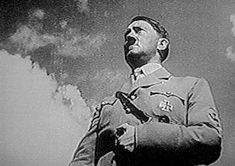 "A clever camera angle used by Riefenstahl in her film makes Hitler appear larger than life on the movie screen - ""Triumph of the Will"""