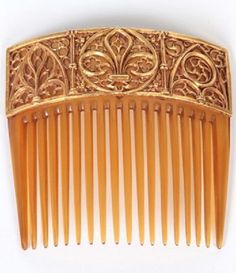 A Gothic Revival comb, by Wiese, Jules & Louis, France, circa 1880. The horn comb set with an 18k gold plaque, ornately carved with fleur de lys and Gothic arches. Signed #WieseJulesLouis #GothicRevival #comb