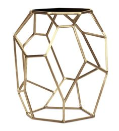 Use this geometric side table to brighten any room with a touch of gold.      FINISH: Satin Brass & Black Marble    [share]