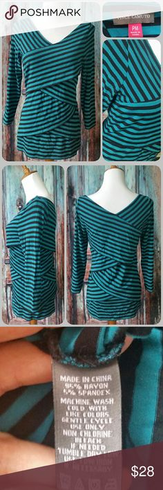 VINCE CAMUTO top Stretchy striped top with diagonal panels on front and back, creating a flattering v-neck. 3/4 length sleeves. Turquoise and black Vince Camuto Tops