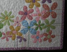 Yeah! It is finished. I might have gotten a bit carried away with the number of flowers on this one. It was just so fun. So many cute retro...