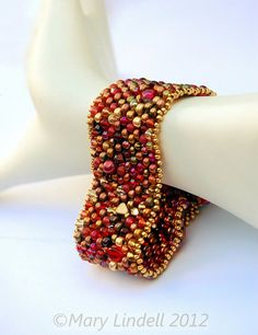 Pearl and Glass Peyote Beaded Cuff in Shades of Red and Gold - Serendipity Bracelet.  via Etsy.