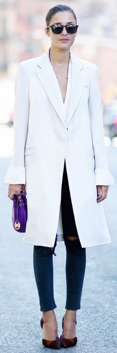 Crisp white knee-length coat, ankle grazing ripped jeans, and patterned heels