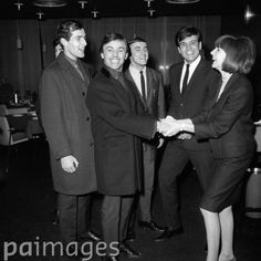 Gerry and the Pacemakers are welcomed back by Cilla Black and Billy J Kramer (both on right) when they arrived in London from their American tour.