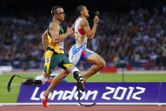 South Africa's Oscar Pistorius (L) runs beside Venezuela's Albert Bravo in the men's 400m semi-final during the London 2012 Olympic Games at the Olympic Stadium August 5, 2012.