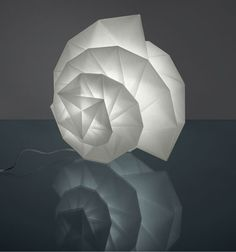 """IN-EI is a new collection of table, floor, and hanging lamps by fashion designer Issey Miyake for the Italian lighting manufacturer Artemide. The fixture's material is made from recycled PET plastic bottles and diffuses light beautifully. """"IN-EI"""" is Japanese for shadow, and with the pleating of the"""