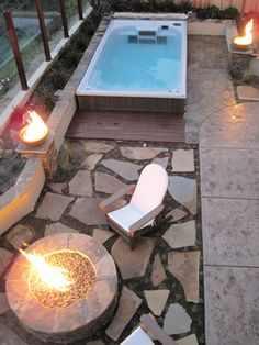 A mini getaway in your own backyard: a hot tub and fire pit.