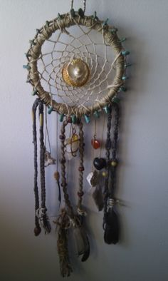 My latest handmade creation of the first dream catcher I've ever made. I made it with hemp, shells, feathers, beads, wrapped sage & old hemp necklaces which all were passed on to me by good friends:) Embellished with my citrine crystal, carnelian & tiger's eye gemstone, outer wrapped with a shell and turquoise gemstone necklace that was passed on to me from my grandmother.  Handmade with love by Cher Sum Love www.chersumlove.com  #Handmade #Dreamcatcher