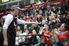 Stilt Guys get the younger fans pumped up for the game!