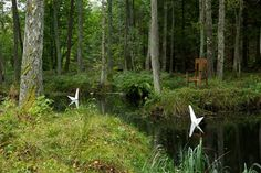 paper swans in a wooded retreat. by urnatur.