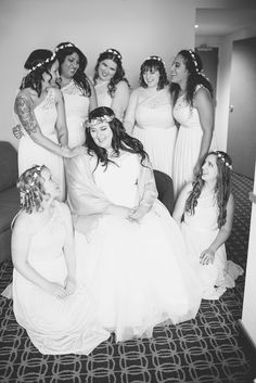 David's Bridal bride Lizzie in a cap sleeve lace and tulle ball gown with her bridesmaids in one shoulder lace bridesmaid dresses! Love the flower crowns on the bride and bridesmaids! Photo: Maria Grace Photo