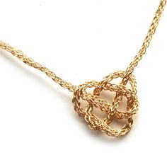 The Celtic heart knot necklace is made of wire gold filled, the wire is crocheted into a gold chain and a Celtic knot in a heart shape is created. This is a very unique necklace, the chances you see a