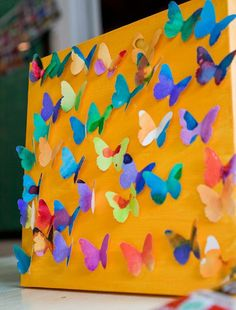 What an awesome art idea for kids!   3D Art Canvases with butterflies