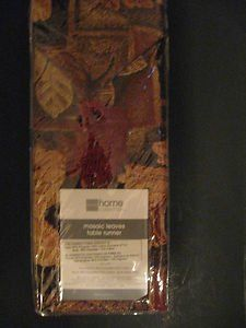 "Mosaic Leaves Table Runner Tapestry Fall Leaves 13 "" X 72"" by J C Penney. $39.95. Table Runner. Fall Colored Leaves. 13"" X 27"". Beautiful burgundy, golds and browns make up the tapestry in this 13 X 72"" table runner. Each end is trimmed with a burgundy tassel."