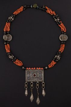Tajikistan   Early 1900s necklace.  Mediterranean coral, silver, glass beads, amulet container pendant.