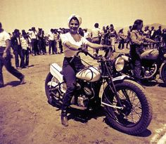 Vintage 50's-era candid photo captures Patti Waggin preparing for another motorcycle club riding competition..