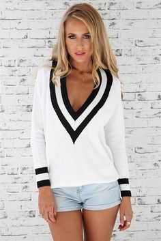 Varsity Sweater with black lace bandeau..jeans and boots