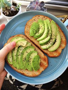kate-loves-kale: Breakfast! Rye toast with avocado and lemon juice