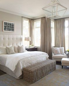Traditional Master Bedroom with Jayson home rattan bench, Floor to ceiling curtain, Crown molding, Pendant light