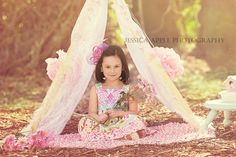 Shabby chic photo shoot inspired by spring and tea parties. I adore how the girly tent turned out!! Photography props included tent, birdhouse, pom poms, flowers, and over the top hair accessories. Greenville, SC Photography