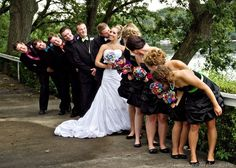 Fun wedding photo idea... and its so neat how well the colors stand out when contrasted with the black. This would be a good alternative for a bride who doesnt want too much color, but also doesnt want her bridesmaids wearing white on her special day.