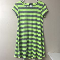 T-Shirt Dress Lime green and grey striped T-shirt dress.  Cap sleeves. Lightweight material.  No size tag, but measures approximately 17 inches across the chest so I'm guessing like a medium (see last pic) and the length is approximately 33 inches measuring from the shoulder seam to the hem.  Cute and casual!  Bundle and save! Peep Studio Dresses Mini