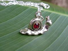 Charming little guy! Happy Snail Necklace - Sterling silver charm & chain, red crystal