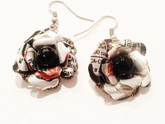 These earrings are created from carefully hand cut upcycled Diet Coke aluminum can. The upcycled flowers are nestled in a pretty antiqued silver metal filigree base with a black glass bead middle. **N