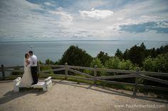 wedding photo on west bluff above Grand Hotel overlooking Mackinac bridge on Mackinac Island, Michigan #MackinacIsland #Wedding #Carriage