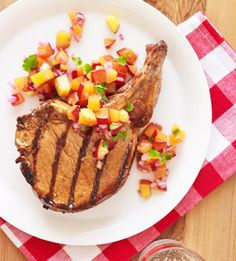 Peaches, plums, jalapeno peppers, and red onions make a colorful, sweet, and spicy salsa to accompany pork chops in this main-dish recipe.