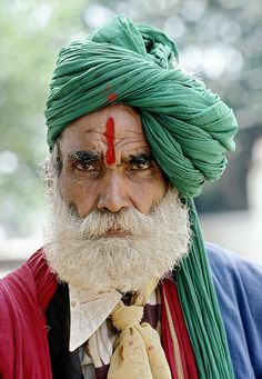 Portrait of Fortuneteller, India, old man, turban, beard, lines of life, powerful face, intense eyes, portrait, photo