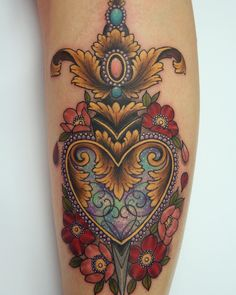 Gorgeous colors in this brocade heard and dagger tattoo