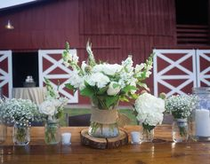 Love these white table centerpieces. See more from this Nashville wedding with a dusty mint theme and vintage details at Lilac Farms at Arrington Vineyards! Pics by Alisha Crossley | The Pink Bride® www.thepinkbride.com