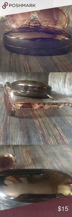 Ann Taylor Loft sunglasses with case Ann Taylor Loft sunglasses with case. There are a couple scratches in the lenses but doesn't affect your vision. Very cute. Clear with black designs. Ann Taylor Accessories Sunglasses