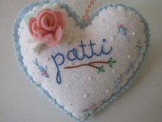 Felt Heart <3....(very pretty heart...and i love the complimentary embroidery stitches as well as felty rose.)