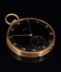 ART DECO 14K ZENITH POCKET WATCH: Early 1940s 14K yellow gold Zenith open face pocket watch. Triple signed dial, case and watch. The case is in the Deco Empire design. The dial is black with Roman numerals and secondary dial. The movement is in need of a main spring. 45mm dia. Gold Weight: 10.0 grams approx.