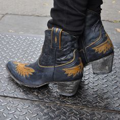 Old Gringo short cowboy boot! Dark jean colored leather with inlayed butter caramel colored eagle on the foot. Boot has heel and a pointy-round toe. Old Gringo Boots, Old Boots, Shoe Boots, Shoes, Dark Jeans, Blue Jeans, Cowboy Boot Store, Short Cowboy Boots, Distressed Leather