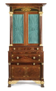 Classical Carved and Figured Mahogany, Ormolu-mounted, Parcel Gilt and Stenciled Desk-and-Bookcase with Eagle carved feet, attributed to the shop of Joseph Meeks and Son, New York, circa 1825 -  Appears to retain its original hardware. Height 107 in. by Width 54 in. by Depth 25 1/2 in.